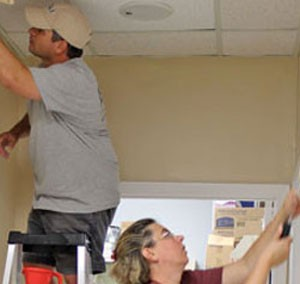 BB&T employees paint inside Mercy Medicine