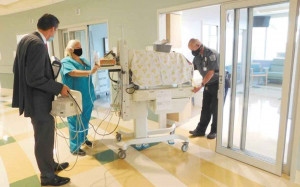 McLeod Regional Medical Center staff members assist with moving Neonatal Intensive Care Unit babies to their private rooms in McLeod Pavilion East.