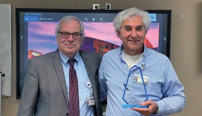 Dr. Dan Lackland, left, presents the 2021 Hypertension Champion of the Year Award to Dr. Gerard Jebaily, program director of the McLeod Family Medicine Residency Program.