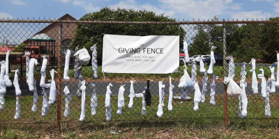 Last week, Vacation Bible School attendees at St. John's Church in downtown Florence made 'Socks of Love' and hung them on a fence behind the church for the homeless and those in need. Each pair of socks was filled with personal hygiene items, such as too