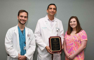 Dr. Adnan Alsaka, center, is pictured with USC School of Medicine Florence Regional Campus medical students Matthew Lancaster, left, and Autumn Lupotsky.