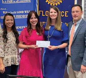 hown, left to right, are Jenna Nance and Cameron Packet of the United Way of Florence County and Ashley Christenbury and Derek Hemmingson of the Rotary Club of Florence.