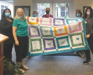 Quilt presented to McLeod  Hospice