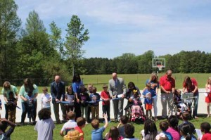 Carver Elementary cuts ribbon on renovated playground,  unveils new inclusive playground equipment