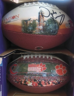 Toys For Tots auctioning Clemson footballs signed by Coach Dabo Swinney