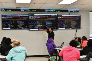 Aaron Stevens, who teaches the Bloomberg Market Concepts course at South Florence High School, says his students have been drawn to the fact that they can track the stock prices for brands they are familiar with. The new course offers instruction on econo