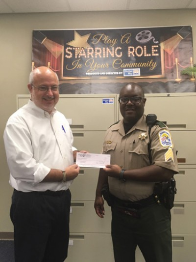 United Way presents checks to Police Department and Sheriff's Office