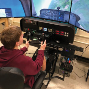 Prepared for takeoff School district's aerospace engineering course  enhanced by use of new flight simulator
