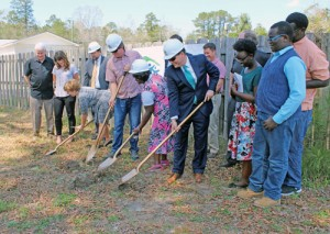 Widow with four children breaks  ground for their Habitat home