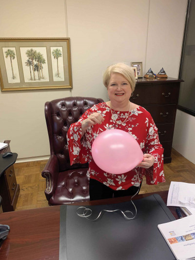 Breast cancer survivor Harrelson says support from  family, co-workers, medical staff made  all the difference