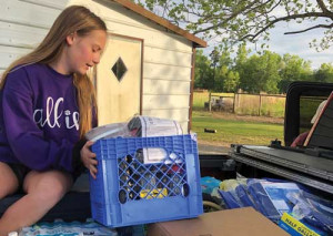 4-H members perform service projects