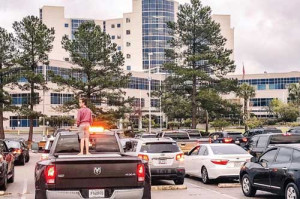 TWINKLE PARADE: Motorists flash headlights in support of medical workers